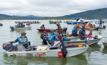 TERENGGANU,MALAYSIA - NOV 30,2017: Unidentified anglers from Abu Garcia Team in the Asean Monsoon Casting Tournament 2017 at Kenyir Lake. Kenyir Lake is one of heaven location for fresh water fishing.