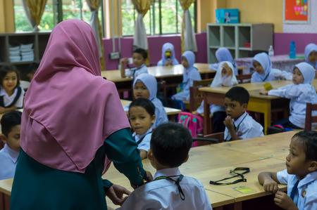 PUTRAJAYA, MALAYSIA - Jan 2, 2018 : Malaysian primary school student attending first day school session 2018 at Putrajaya.