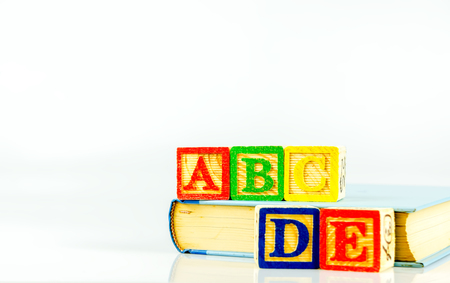 Close up arrangement of alphabet isolated on white background. Preschool, education concept or other your content. Archivio Fotografico