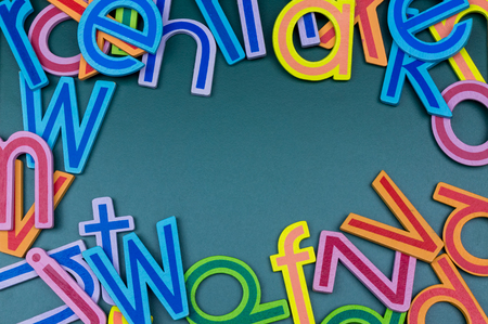 Close up arrangement of alphabet on green board. Preschool, education concept or other your content.
