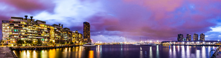 Panorama view of a beautiful view of docklands and The Bolte Bridge with a cloudy sky and twilight in Melbourne Australia. Stock Photo