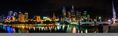 riverbank: A beautiful view of Melbourne downtown across the Yarra river at night in Melbourne, Victoria, Australia.