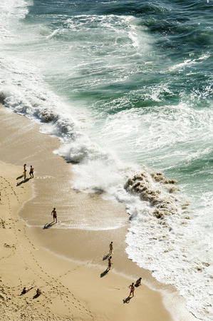 bathers: Bathers contemplating the heavy sea, Portugal Stock Photo