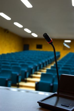 cushioned: Microphone in an empty auditorium