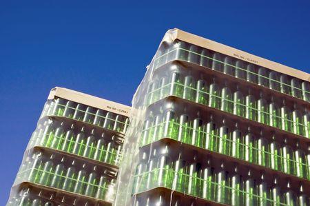Huge stack of green glass bottles