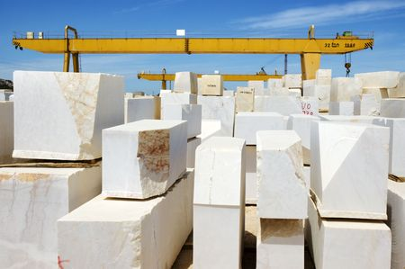 quarry: Marble blocks aligned in factory yard, Alentejo, Portugal