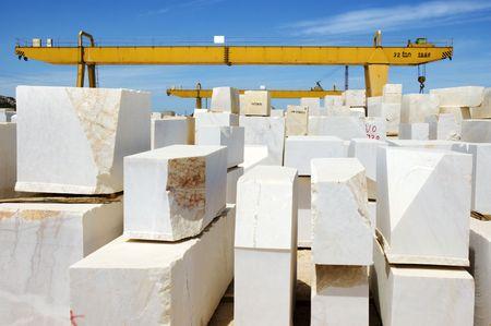 Marble blocks aligned in factory yard, Alentejo, Portugal