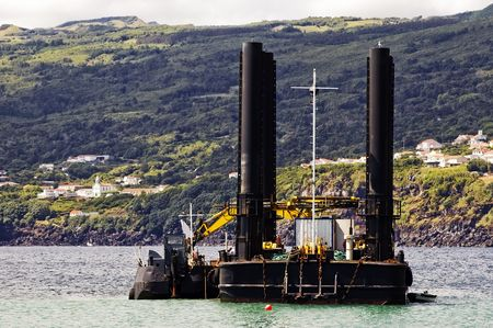 dredger: Dredger and barge working near the shore Stock Photo