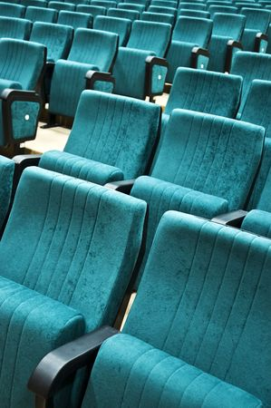 cushioned: Rows of chairs in an empty auditorium