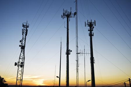 Telecommunications towers, relays and mobile radio antennas photo