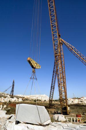 Cranes and marble blocks at a quarry near Vila Viçosa, Alentejo, Portugal