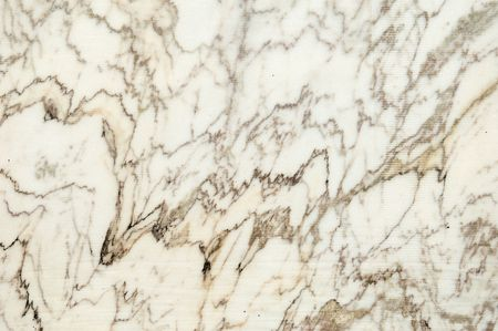 Texture of a tarnish block of marble freshly cut in the quarry