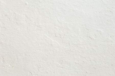 Detail of a rugged white wall suitable as background Stock Photo - 2251757