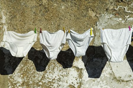 Knickers drying hanged in a cloth line