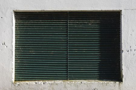repetitious: Detail of white wall with a ventilation grate