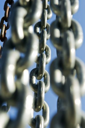 Group of chains against a blue sky