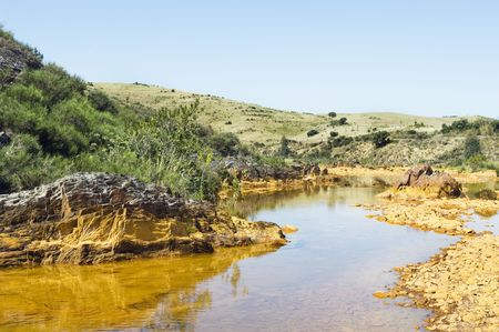 Detail of polluted river by chemicals near an abandoned mine photo