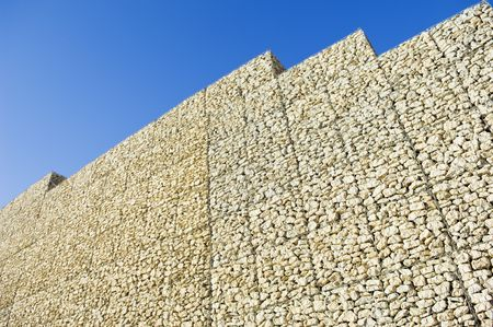 meshed: Safety wall made of stacked meshed boxes of stones