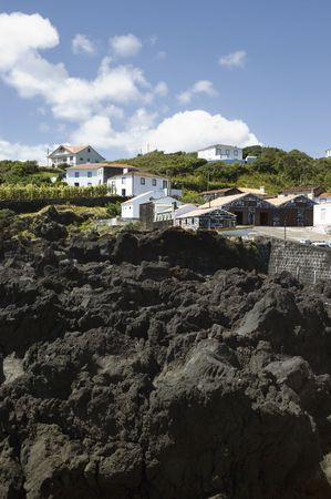 volcanic stones: Basalt rocks beside a small  village in  Pico island, Azores, Portugal