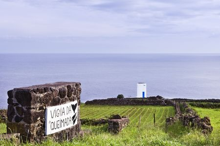 volcanic stones: Whale watch tower hanging over the cliff, Pico island, Azores  Stock Photo