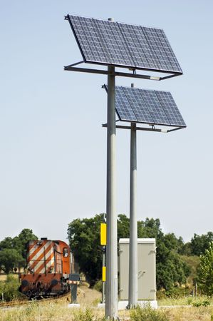 technologically: A view of two large solar panels used to power signals and safety equipment associated with a railroad crossing.