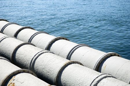 A closeup of large sewage pipes, leading out to the sea. Standard-Bild