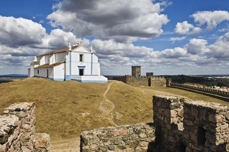 crenelation: Church of Salvador inside the castle of Arraiolos, Alentejo, Portugal