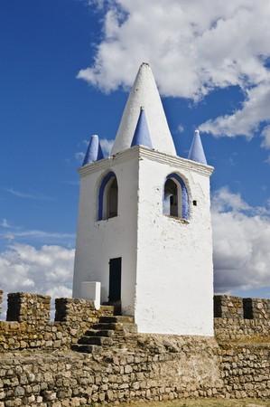 crenelation: Belfry over the medieval walls of the castle of Arraiolos, Alentejo, Portugal