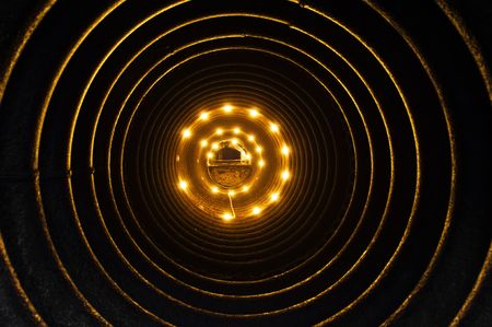 Inside of a pipe illuminated by electric lamps