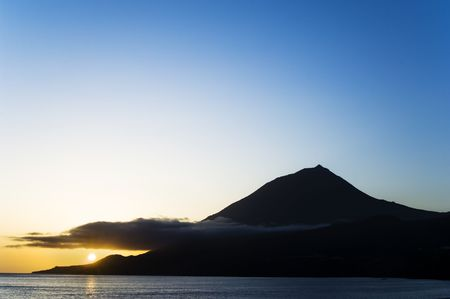 Sunset over the volcano of Pico island, Azores photo