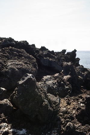 Volcanic rock in Pico island costline, Azores Stock Photo - 9144781