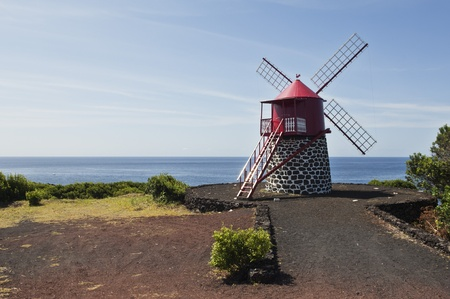 Red windmill in the coast of Pico island, Azores