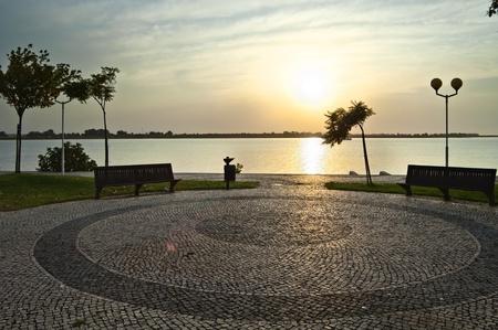 Sunrise over Guadiana river an the cobblestones of Vila Real de Santo António, Algarve, Portugal Stock Photo