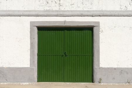 Bright green old whareouse door photo