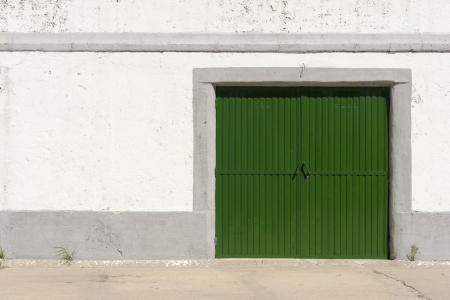 green door: Bright green old whareouse door Stock Photo