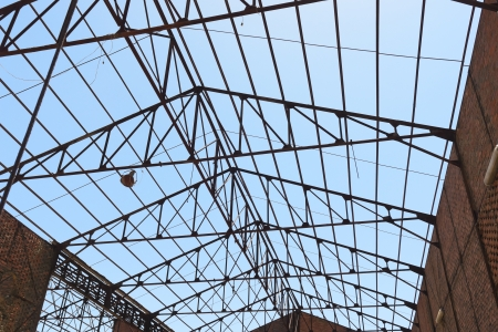 damaged roof: Roof framework of an hangar in abandoned mine Stock Photo