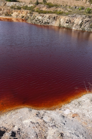 Polluted water pond in the abandoned mine of Lousal, Grandola, Portugal photo
