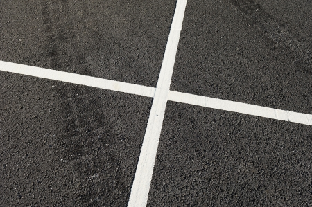 tire marks: Detail of tire marks and white stripes painted on the road