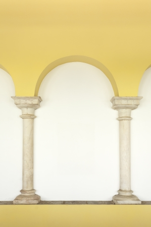 pilaster: Two marble columns embedded in the wall topped by an arch painted in yellow, Elvas, Portugal