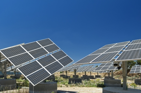 Photovoltaic silicon panels with tilted single axis track system in a small solar power plant, Portugal photo