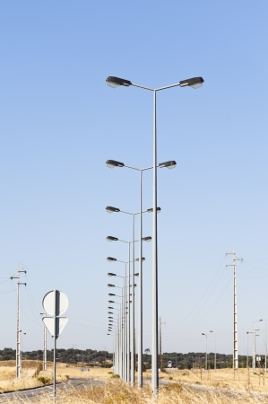 streetlight: Street lights in fully infra-structured vacant lots ready for construction in the industrial park of Evora, Portugal Stock Photo