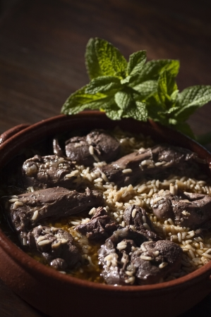Real food photographed on location in traditional portuguese restaurants, hare cooked on red wine with rice - arroz de lebre - Alentejo, Portugal Standard-Bild