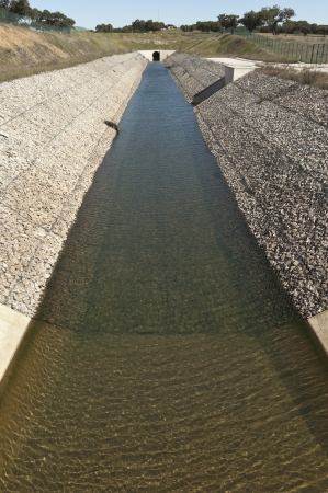 gabion: Water diversion canal upstream the Alvito reservoir near Oriola village, part of the Alqueva Irrigation Plan, Alentejo, Portugal
