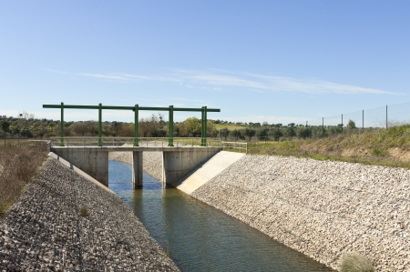 diversion: Almost finished sluice gate in the water diversion canal upstream the Alvito reservoir near Oriola village, part of the Alqueva Irrigation Plan, Alentejo, Portugal Stock Photo