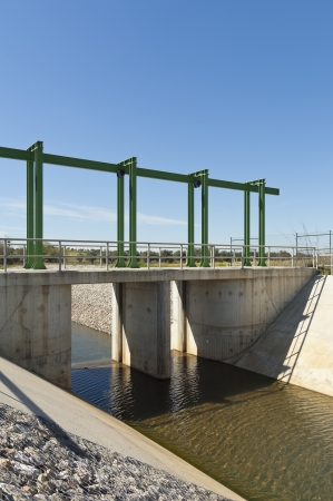 upstream: Almost finished sluice gate in the water diversion canal upstream the Alvito reservoir near Oriola village, part of the Alqueva Irrigation Plan, Alentejo, Portugal Stock Photo