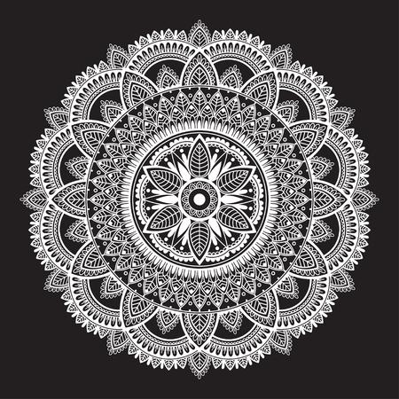 White round ethnic mandala on black background. Circular decorative pattern.
