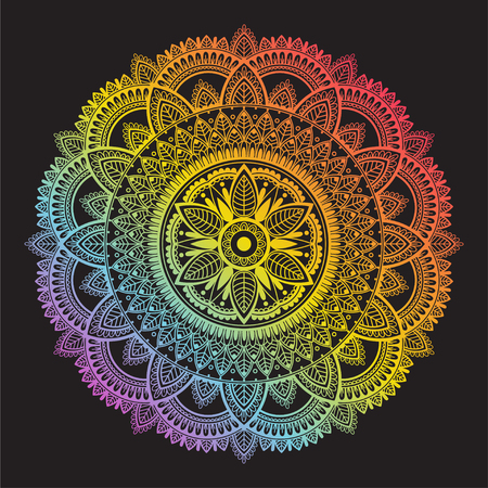 Colorful rainbow ethnic mandala on black background. Circular decorative pattern.