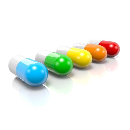 pastille: Colorful Pills Set with Reflection on White Background
