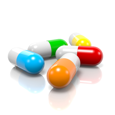 Colorful Pills with Reflection on White Background photo