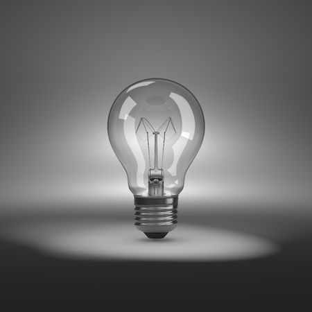 spot lit: One Single Light Bulb under Spotlight
